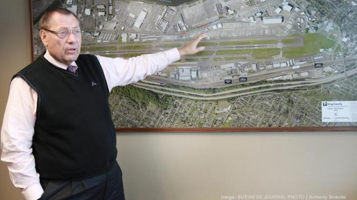 Randy Berg at map of airport