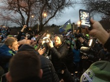 Sounders Goalkeeper holds the MLS Cup while greeted by fans at King County International Airport/Boeing Field