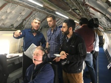 Researchers and media aboard a 757 discuss NASA's new Flight Deck Interval Management Technology, which is being tested at King County International Airport/Boeing Field