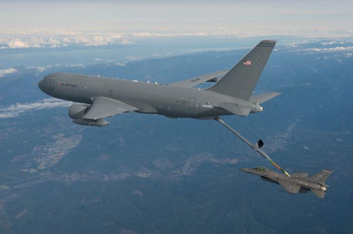 A KC-46 refules an F-16 fighter jet