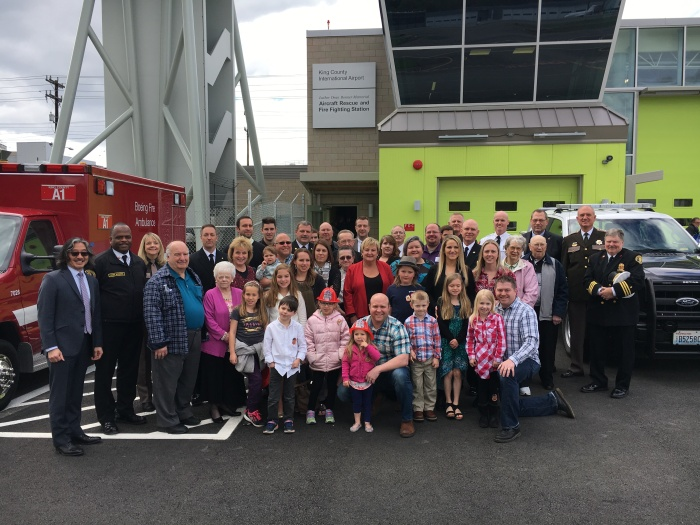Members of the local firefighting community gather for a group photo in front of the Luther Dean Bonner Memorial Aircraft Rescue and Fire Fighting Statio on Monday, April 17, 2017.