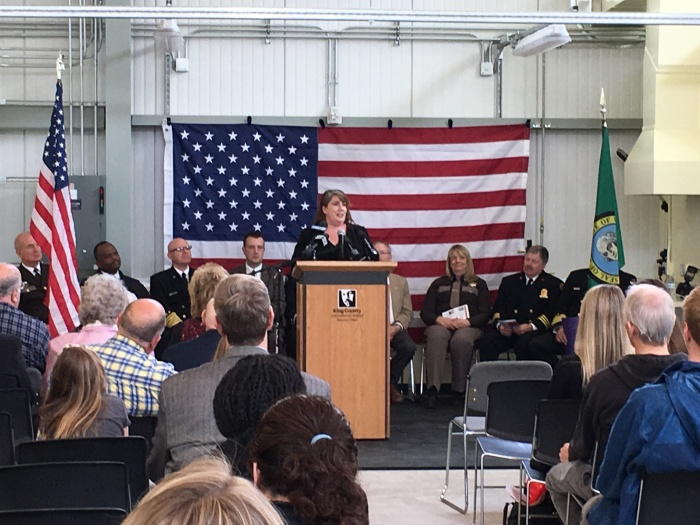 Sandy Karwhite, wife of Tukwila Firefighter Jason Karwhite, addresses the crowd during the dedication of the Luther Dean Bonner Memorial Aircraft Rescue and Fire Fighting Station on Monday, April 17, 2017.
