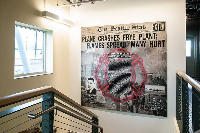 A mural that tells the story of fallen Seattle Firefighter Luther Dean Bonner hangs inside of the Luther Dean Bonner Memorial Aircraft Rescue and Fire Fighting Station at King County International Airport/Boeing Field.