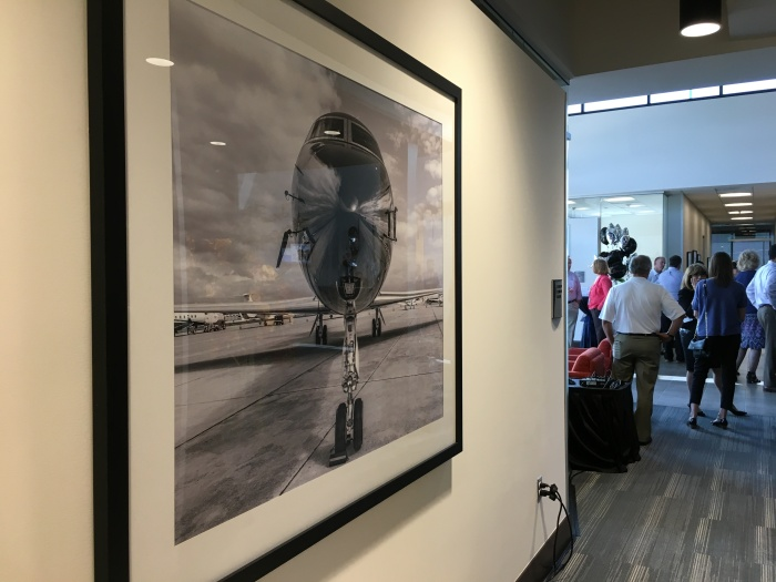 A framed picture of an airplane hangs at Signature Flight Support's new executive terminal at King County International AirportBoeing Field.