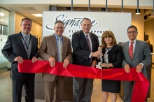 Officials pose during the ribbon-cutting of Signature Flight Support's ne executive terminal at King County International Airport/Boeing Field on Tuesday, Aug. 8, 2017.