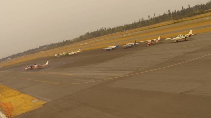 General aviation planes wait on the runway of Bremerton National Airport.