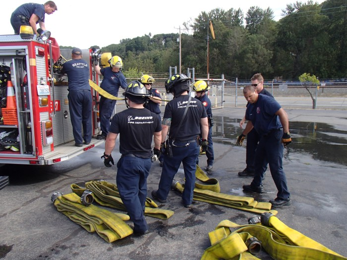 Firefighters organize during a multi-agency water training exercise in August at King County International Airport/Boeing Field.