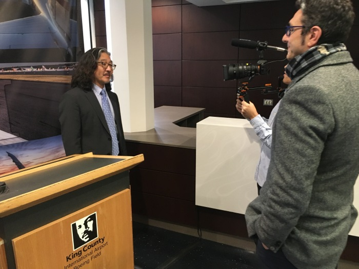 Harold Taniguchi, Director of King County Department of Transportation, discusses with media King County International Airport/Boeing Field's recent efforts to improve energy efficiency in its Main Terminal building.