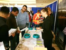 Charity Catalfomo, Airport Safety & Security Manager, discusses career and internship opportunities with prospective applications at King County International Airport/Boeing Field's Career & Internship Fair in March 2018.