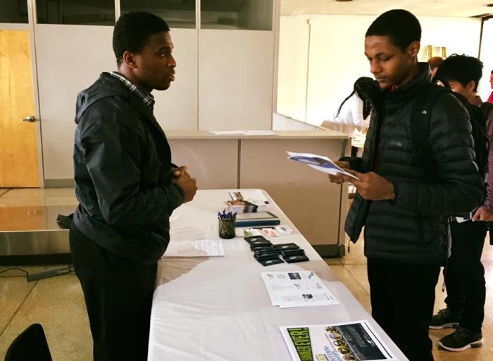 A potential applicant studies printed information about the Port of Seattle during King County International Airport/Boeing Field's Career & Internship Fair in March 2018.