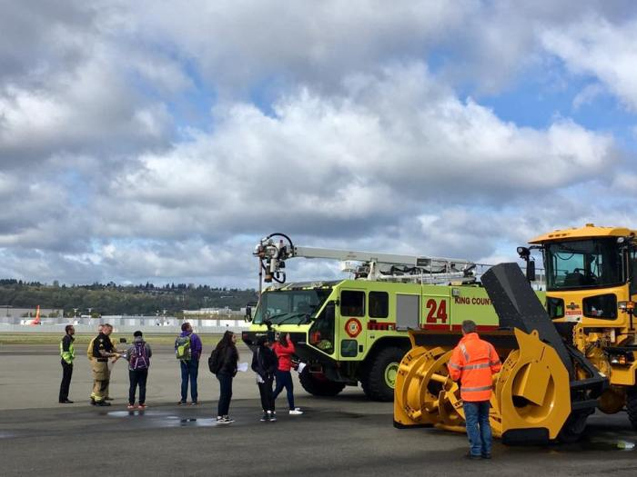 Students from Foster High School in Tukwila inspect vehicles from King County International Airport/Boeing Field's Airport Rescue & Firefighting unit (ARFF) on the tarmac. The visit was part of DiscoverU.