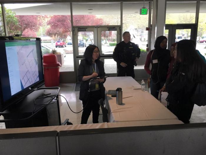 Students from Fostrer High School in Tukwila listen to King County International Airport/Boeing Field staff as part of DiscoverU on April 17, 2018.