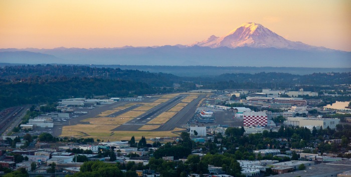 The morning sunrise illuminates Mount Rainier as it overlooks King County International Airport/Boeing Field.